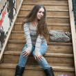 Stock Photo: Beautiful girl sitting on wooden stairs