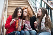 Three beautiful girls with shopping — Stock Photo