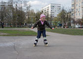 Young girl riding on roller skates. — Stok fotoğraf