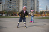 Young girl riding on roller skates. — Stock Photo