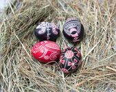 Colorful Easter eggs in a little basket. Easter background, spring themes — Stock Photo