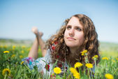 Beautiful young brunette woman  on the  meadow with — Stock Photo