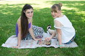 Looks like hand of girl moves chess piece on chessboard in park. — Stock Photo
