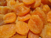 Dried apricots orange background — Stock Photo