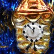 Christmas and New Year tree decorations gold clock on a blue background — Photo