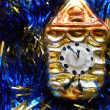 Christmas and New Year tree decorations gold clock on a blue background — Stock Photo #34799643