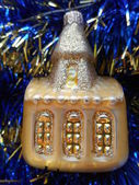 Christmas and New Year tree decorations gold house on a dark blue background — Stock Photo