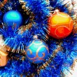 Christmas and New Year decoration balls and tinsel blue abstract background — Stock Photo