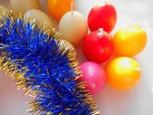 Christmas and New Year candles and tinsel on white background — Stock Photo