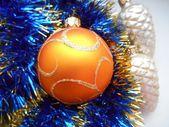 Christmas and New Year's ball and tinsel blue background — Stock Photo