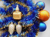 Christmas and New Year decoration balls and tinsel blue background — Stock Photo