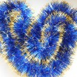 Christmas and New Year blue and gold tinsel heart background — Stock fotografie