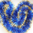 Christmas and New Year blue and gold tinsel heart background — Stockfoto