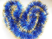 Christmas and New Year blue and gold tinsel heart background — Photo