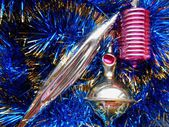 Christmas and New Year decorations on a background of blue tinsel — Stock fotografie