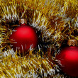 Christmas and New Year decorations red balls on a golden background — Stock Photo #35163553