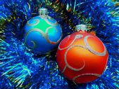 Christmas and New Year's balls on a blue abstract background — Stock Photo