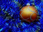 Christmas and New Year decorations golden ball on a blue background — Stock Photo