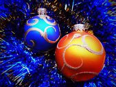 Christmas and New Year's balls on a blue background — Stock Photo
