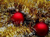 Christmas and New Year decorations red balls on a golden background — Stock Photo