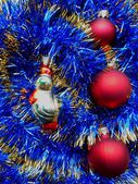 Christmas and New Year decorations red balls on a blue background — Stock Photo