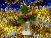 Christmas and New Year decoration bell on a golden background — Stock Photo