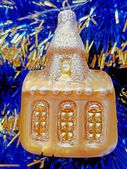 Christmas and New Year's decoration golden house on a blue background — Stock Photo