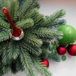 Christmas and New Year decorations red balls  firtree  and green candle and stones — Stock Photo