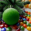 Christmas and New Year decoration-tree candle and colored stones — Stock Photo #35405237