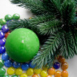 Christmas and New Year decoration-tree candle and colored stones — Stock Photo