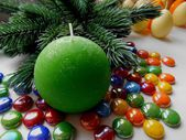 Christmas and New Year decoration-tree candle and colored stones — Stockfoto