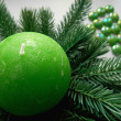 Christmas decoration firtree and green candle — Stock Photo