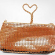 Golden shiny handbag on a white background — Стоковая фотография