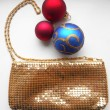 Gold shiny handbag and Christmas balls  — Стоковая фотография