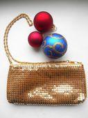 Gold shiny handbag and Christmas balls — Stock Photo
