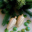 Christmas decoration firtree and pine cones — Stock Photo