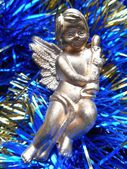 Christmas decoration angel on a blue background — Stock Photo