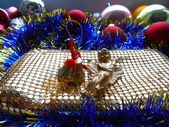 Christmas decoration angel and balls background — Stock Photo