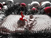 Christmas decoration angel on a red balls background — Stock Photo