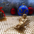 Christmas decoration angel and balls on a golden background — Stock Photo