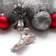 Christmas decoration angel and balls on a tinsel background — Stock Photo #35829961