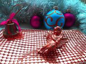 Christmas decoration angel and balls on a abstract golden background — Stock Photo