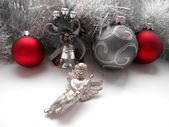 Christmas decoration angel and balls on a tinsel background — Stock Photo