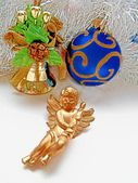 Christmas decoration angel and balls on a tinsel abstract background — Stock Photo
