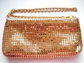 Golden shiny handbag on a white background — Stock Photo