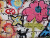 Graffiti on a brick wall background — Stock Photo