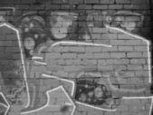 Graffiti na cihlové zdi šedé pozadí — Stock fotografie
