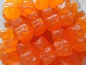 Chewy candy orange background — Stock Photo