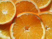 Juicy orange sliced background — Stock Photo