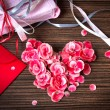 Vintage heart from flowers on wooden table — Stock Photo #13920131